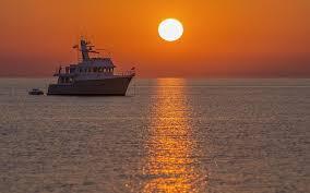 fotos de puestas de sol en el mar playa